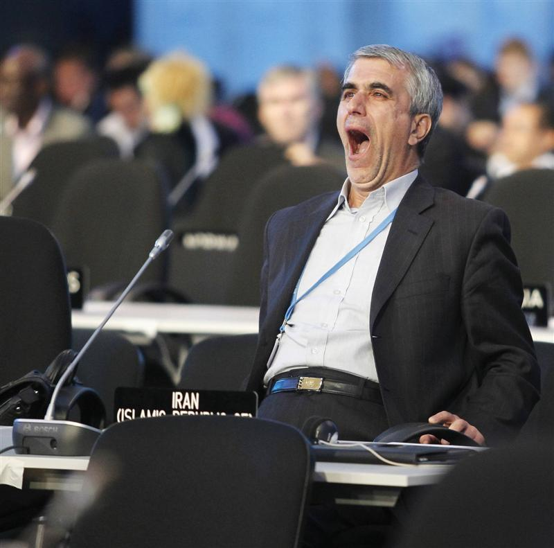 an_iranian_delegate_fights_boredom_during_a_plenar_548fdd514e